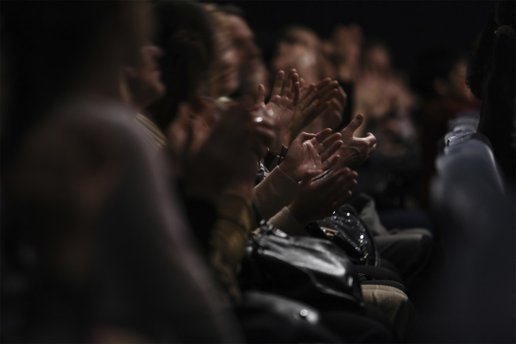 Audience clapping their hands